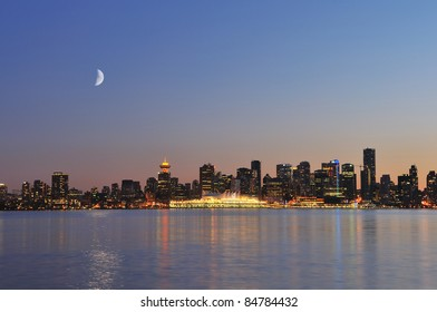 downtown vancouver night scene with crescent moon