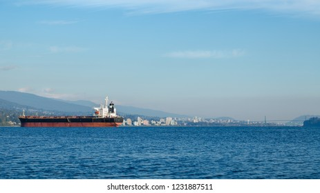 Downtown Vancouver with tanker ships in the foreground.