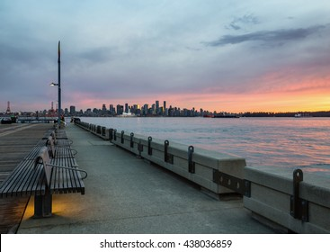 Downtown Vancouver viewed from Lonsdale, North Vancouver, BC, Canada. Picture taken during a colorful summer sunset.