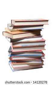 dozen different books, stacked on a white background