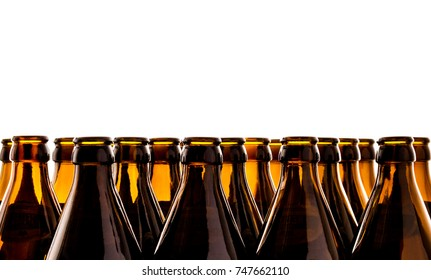 Dozens of empty, brown German beer bottles, isolated as background