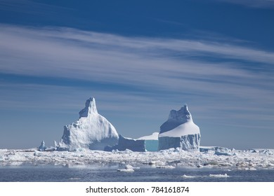 Dozens of icebergs and brash ice in Pleneau Bay, Port Charcot, Antartica