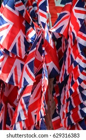 Dozens of Union Jack flags - the flag of Great Britain - flutter in the breeze.