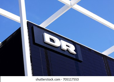 DR – Danmarks Radio DR logotype on building. Danmarks Radio, abbreviated DR is the danish public broadcasting company founded in 1925: Copenhagen, Denmark August 29, 2017