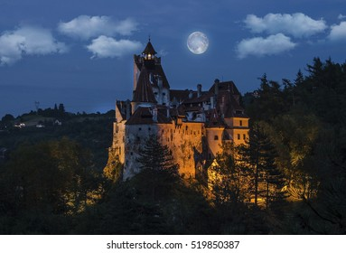 Dracula's medieval castle at night with full moon - Bran , Transylvania. Romania.