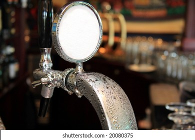 Draft beer tap covered in condensation water droplets