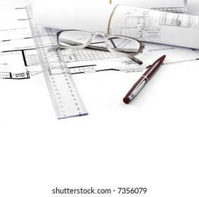 draft home plans with a pen and ruler