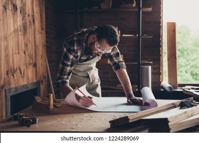 Draft workbench creative profession restoration people person industry concept. Close up photo portrait of smart handsome concentrated workman architect making notes analyzing architecture design plan