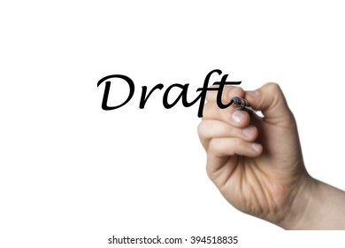 Draft written by a hand isolated on white background