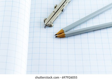 Drafting Compass Pencil On Checkered Drawing Stock Photo (Edit Now