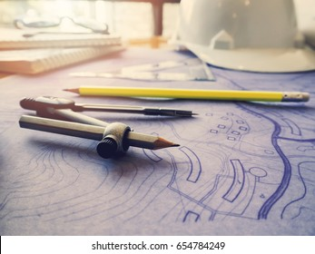 Drafting compass and rulers on blueprints. Architectural concept