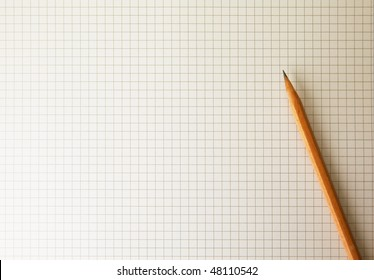 Drafting paper or graph paper with pencil under warm incandescent lighting