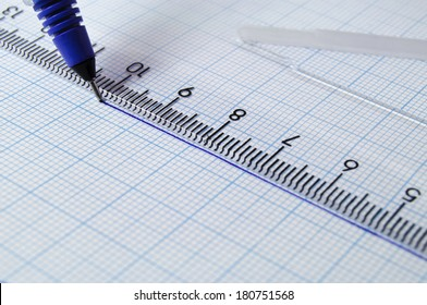 Draftsmanship with pencil and ruler on milimeter paper.