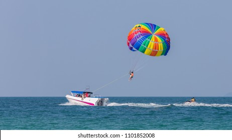 Drag Boat parasailing. Jet Ski driver behind.