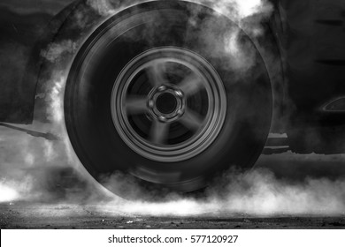 Drag car make tires warm up with smoke, Car racing burns rubber off its tires in preparation for the race.