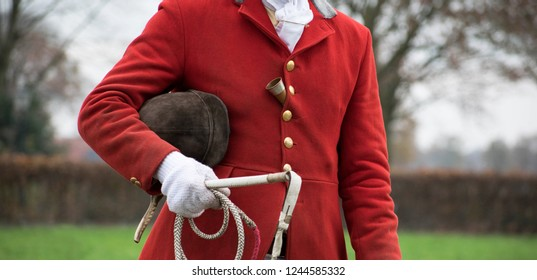 drag hunt portrait drive master. Red coat fox hunt. With cap, whip and horn. hunting scene. Tradition. Netherlands rural area.