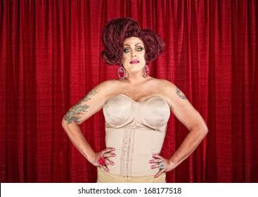 Drag queen in corset with hands on hips