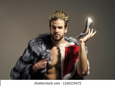 Drag queen, homosexual and trans. Freak, gay and transvestite. Cinderella prince with shoe on grey background. Freedom and lgbt, kitsch. Christmas guy in santa fur coat in crown.