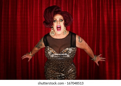 Drag queen screaming or singing in theater