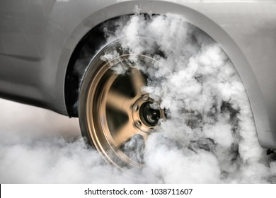 Drag racing car burn  tire at starting line in preparation for t