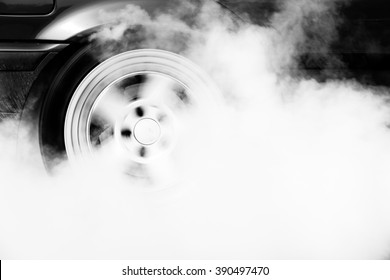 Drag racing car burns rubber off its tires in preparation for the race car