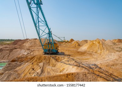 A dragline walking excavator produces sand in a clay quarry. Zaporizhzhya region, Ukraine. June 2012