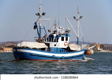 Dragnet fishing boat sailing in Algeciras Bay in Spain.