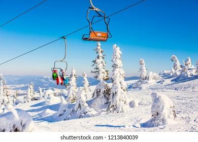 DRAGOBRAT, UKRAINE - March 2018: Chairlift at Dragobrat ski resort on sunny winter day, Ukraine