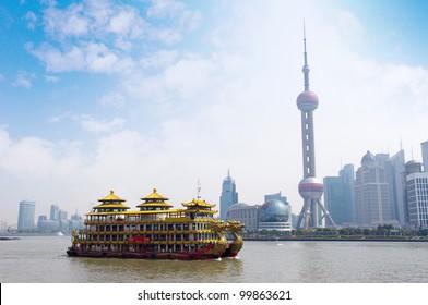 Dragon boat through the Shanghai skyline