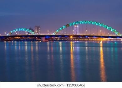 Dragon bridge ( Cua Rong ) with colorful lights at twilight, a bridge over the River Han at Da Nang, Vietnam.