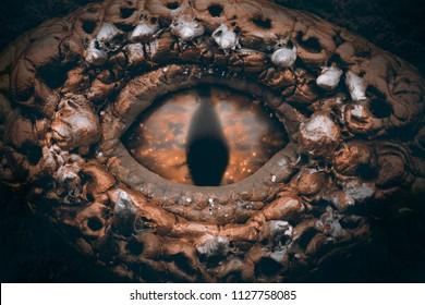 Dragon eye pendant on leather background. Resin craft.