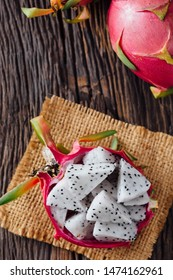 Dragon fruit on wooden table background