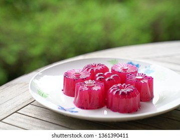 Dragon fruit (red) agar agar (Jelly) sweet dessert served in multiple shapes ready to be eaten