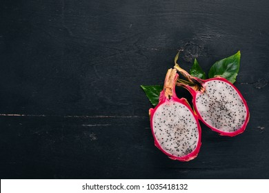 Dragon Fruit. Tropical Fruits. On a wooden background. Top view. Copy space.