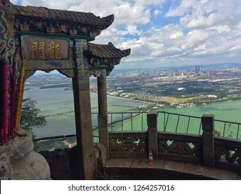 "Dragon Gate at Western Hills, Xishan Forest Park overlooking Kunming, Yunnan, China. Chinese characters mean ""Dragon Gate""."
