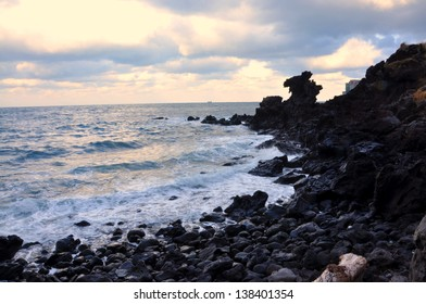 Dragon Head Rock, Jeju, Korea. Yongduam Rock (Dragon Head Rock) was created by strong winds and waves over thousands of years. It's located in Jeju island, South Korea