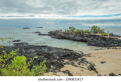 Dragon Hill [Cerro Dragon],Santa Cruz, Galapagos / Ecuador - June 02  2017: Tourists queue to return to ship, after exploring Dragon Hill.