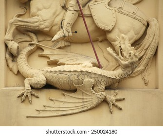 Dragon killed by Saint George. Stucco decoration on the Art Nouveau building in Prague, Czech Republic.