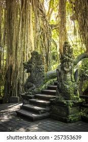 Dragon sculpture on the bridge in monkey forest, Ubud, Bali.