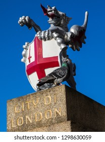 A dragon sculpture on London Bridge in London, UK.  There are various dragon statue boundary markers that mark the boundaries of the City of London.