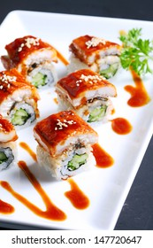 DRAGON SPECIAL MAKI : Grilled Eel ,Kaiware Sprouts,Cucumber and Sesame maki by Fresh Avocado with Special Soy Sauce.