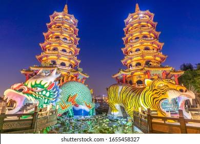 Dragon and the tiger pagoda at the lotus pond at night