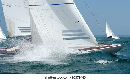 dragon yacht bow with wave and foam at regatta
