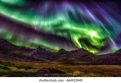 """Dragons landing"" Heavy northern light activity at Myrland in Flakstad, lofoten islands"