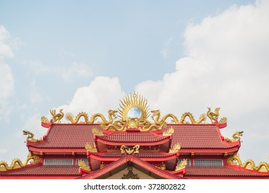 Dragons sculpture on roof with blue sky background. Photo is taken from public place  in chiang mai thailand