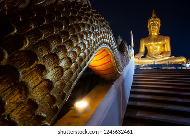 Dragons Staircase leading to a colossal Buddha statue. Pattaya City Thailand at night.