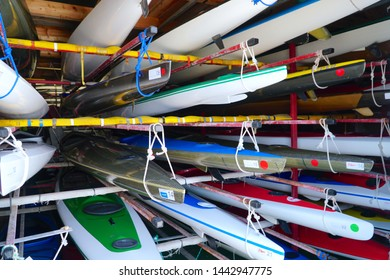 Dragor, Denmark - 19 June 2019: Racks with storage of colorful canoes.