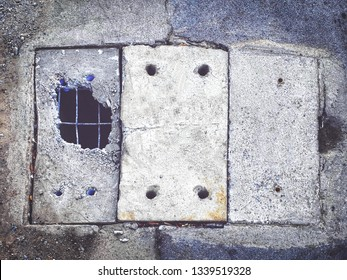 Drain cover made of cement, broken into large holes. cap sewer crack.