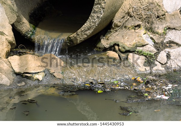 drain pipe or effluent or sewer release waste water into river. Sewage or domestic waste water or municipal wastewater that's product by community of people. waste water is any water that has been use
