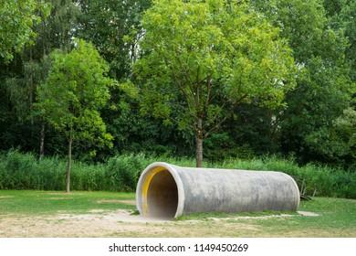 drain pipe as playground in National Park Biesbosch, Merwelanden, Dordrecht, The Netherlands